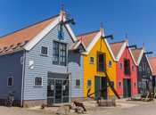 Row of colorful houses at the harbor of Zoutkamp