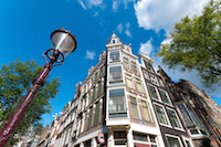 low angle view of some typical amsterdam houses and a lamppost